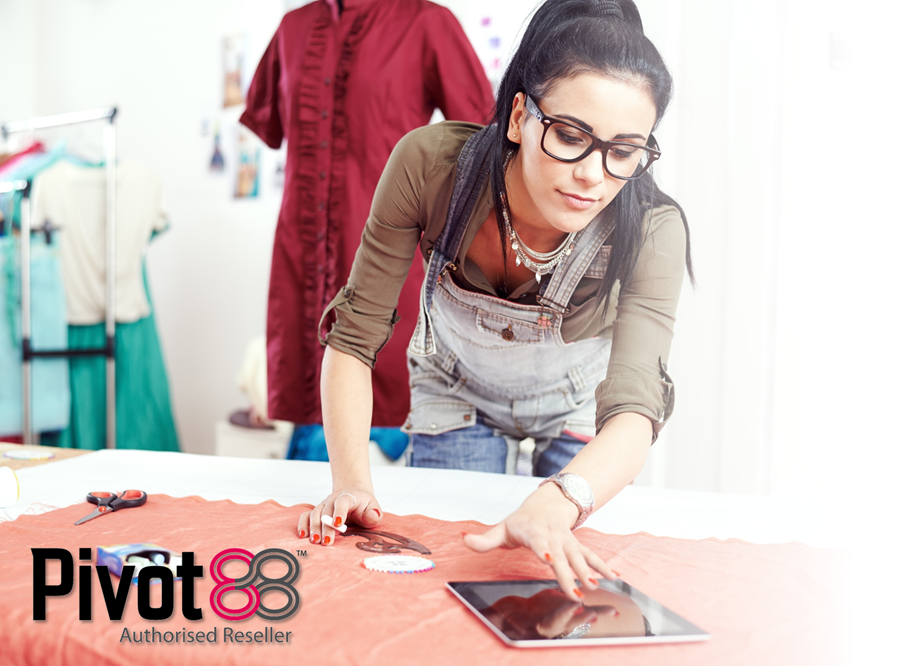 Young female fashion designer using Pivot88 Solutions on an iPad Tablet to ensure color specifications and quality control